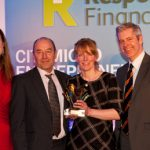 Mick Brown, CEO, and Jackie Milton, Investment Manager, collect the award from Justin Webb.